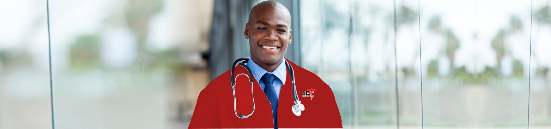 smiling male doctor wearing red uniform